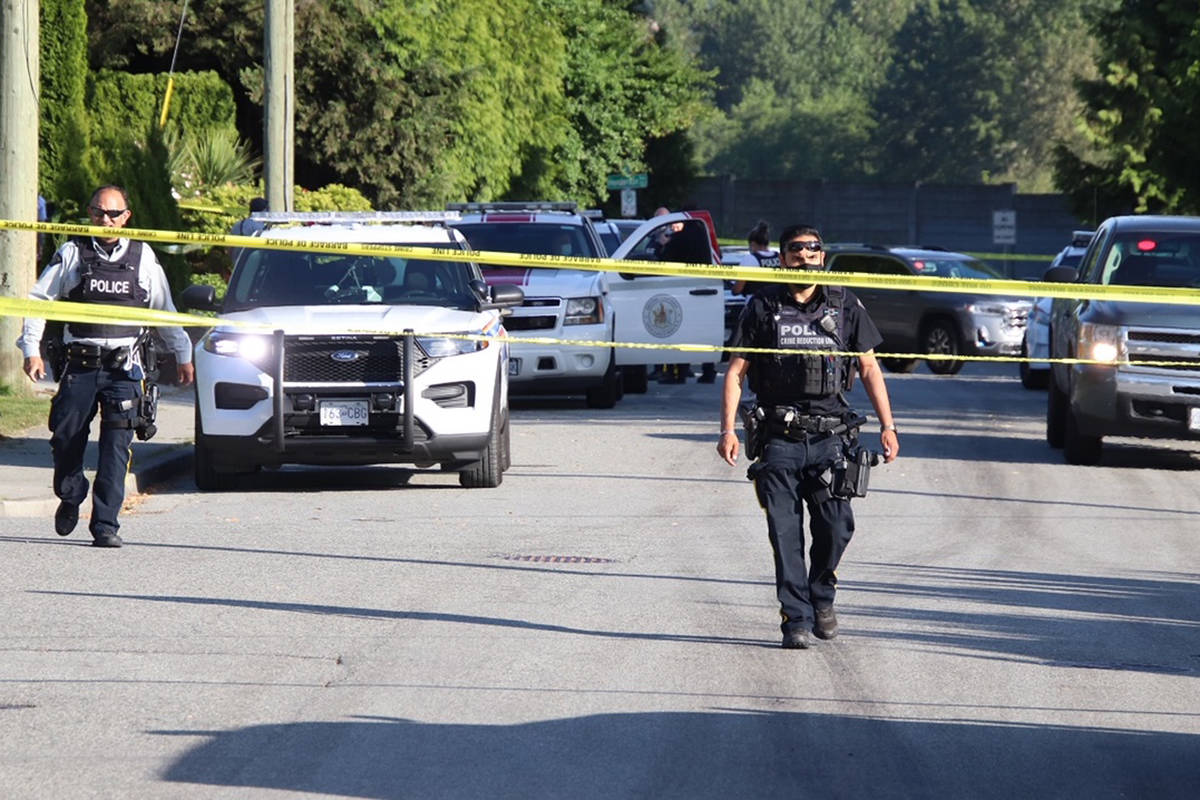 Police investigate a fatal shooting in Coquitlam on Saturday, May 22, 2021. (Shane MacKichan)