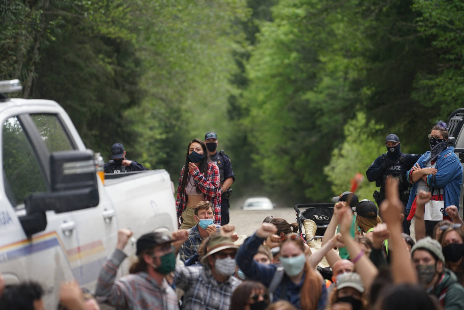 On Saturday a group of protestors peacefully walked past an RCMP checkpoint at Caycuse. Several were later arrested. (Tristan Crosby/Submitted)