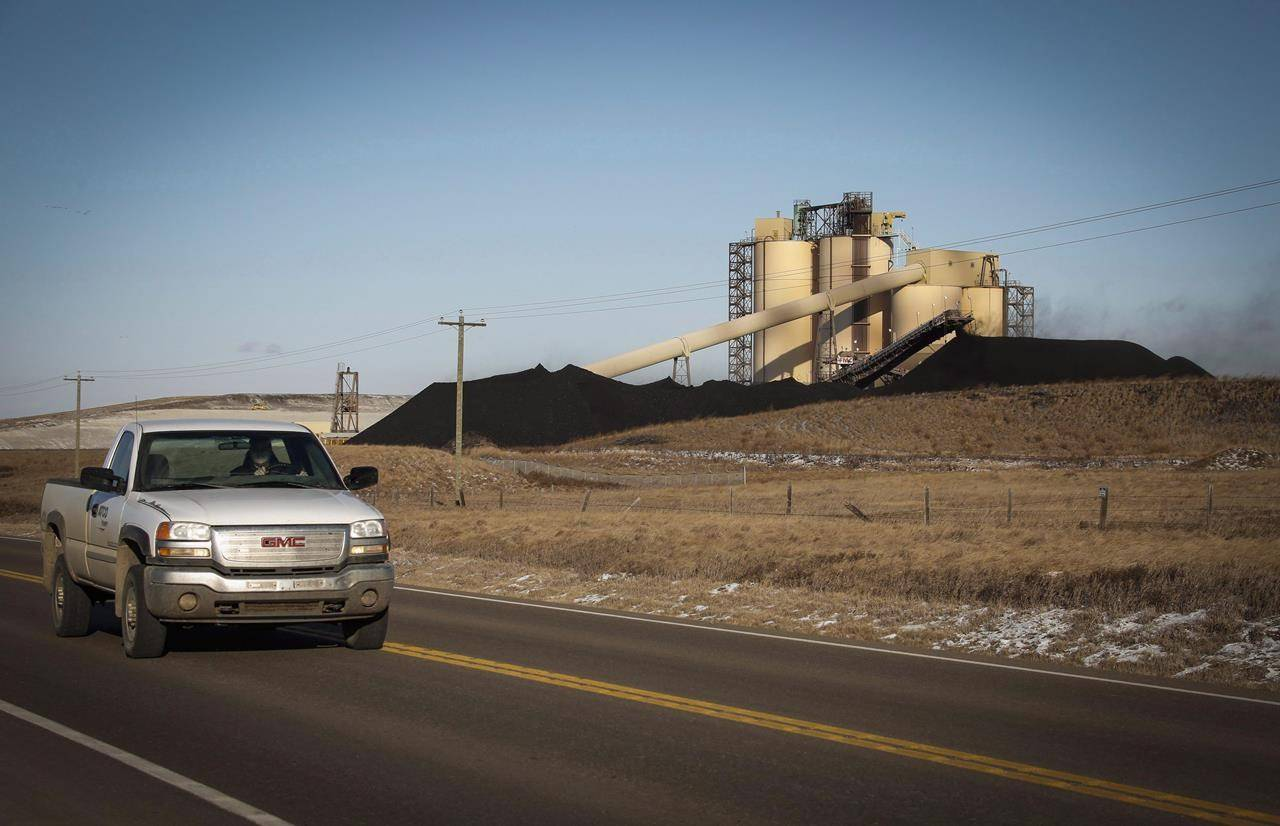 A conveyor belt transports coal at the Westmoreland Coal Company's Sheerness Mine near Hanna, Alta., Tuesday, Dec. 13, 2016. Coal mines can be environmentally safe and can become useful, enjoyable landscapes when the seam runs out, say scientists working with industry. THE CANADIAN PRESS/Jeff McIntosh