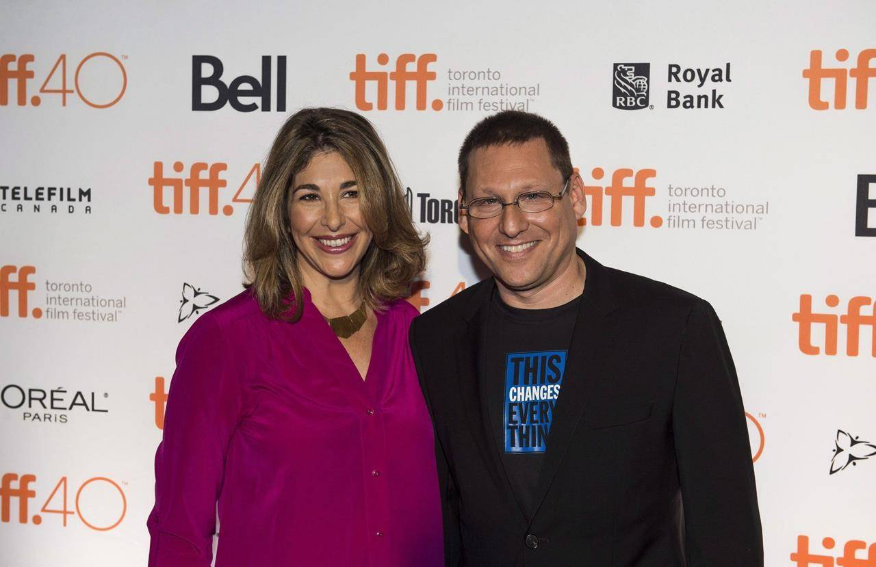 Director Avi Lewis, right, and author Naomi Klein of the film 'This Changes Everything,' stand for a photo on the red carpet during the Toronto International Film Festival press conference in Toronto on Wednesday, August 5, 2015. Documentary film producer Avi Lewis has been acclaimed as the federal NDP candidate in a riding in southern British Columbia. THE CANADIAN PRESS/Aaron Vincent Elkaim