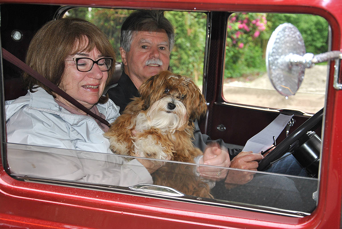 Bob and Berla McLaughlin of Surrey, with scruffy little Sophie, took part in a small car rally that drove through the village of Fort Langley Monday, to mark Victoria Day and to replace the traditional May Day Parade that would have been in its 99th year – if not for COVID. (Roxanne Hooper/Langley Advance Times)
