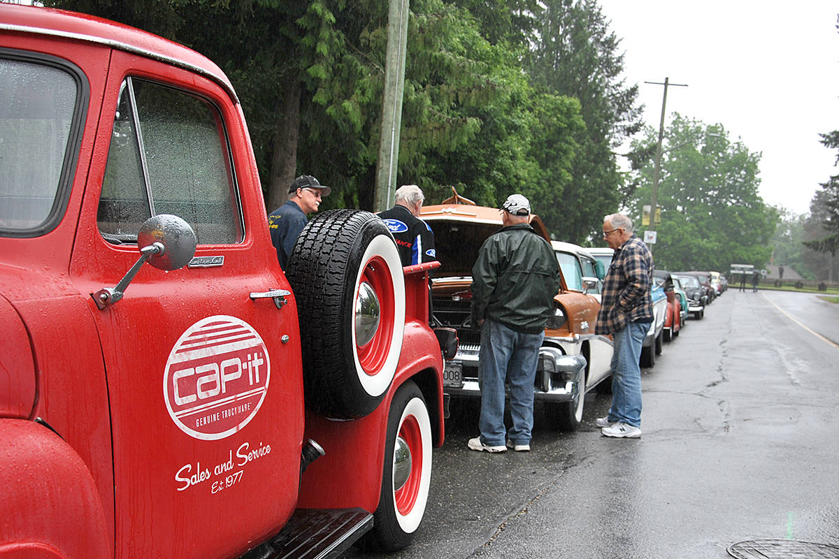 Close to 30 car collectors brought their vehicles out for a 'drive' through downtown Fort Langley on Monday. The rather impromptu car rally was designed to replace the traditional May Day Parade and festivities that could not happen as a direct result of COVID-19 safety restrictions. (Roxanne Hooper/Langley Advance Times)