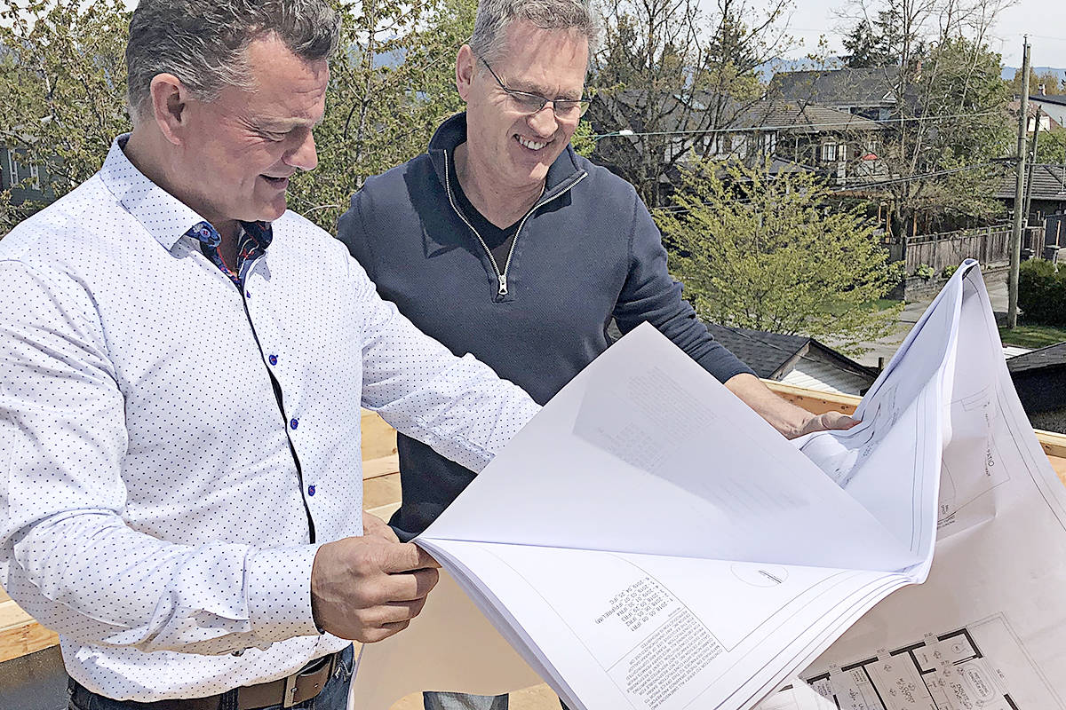 Larry Clay (left) on a job site, reviewing plans. (Special to Langley Advance Times)