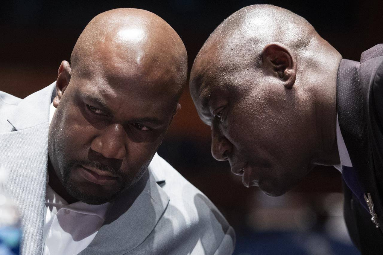 FILE - In this June 10, 2020, file photo, Philonise Floyd, a brother of George Floyd, speaks with civil rights attorney Ben Crump, right, during a House Judiciary Committee hearing. (Michael Reynolds/Pool via AP, File)