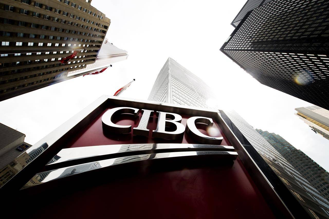 A CIBC sign is shown in the financial district in Toronto on August 22, 2017. THE CANADIAN PRESS/Nathan Denette