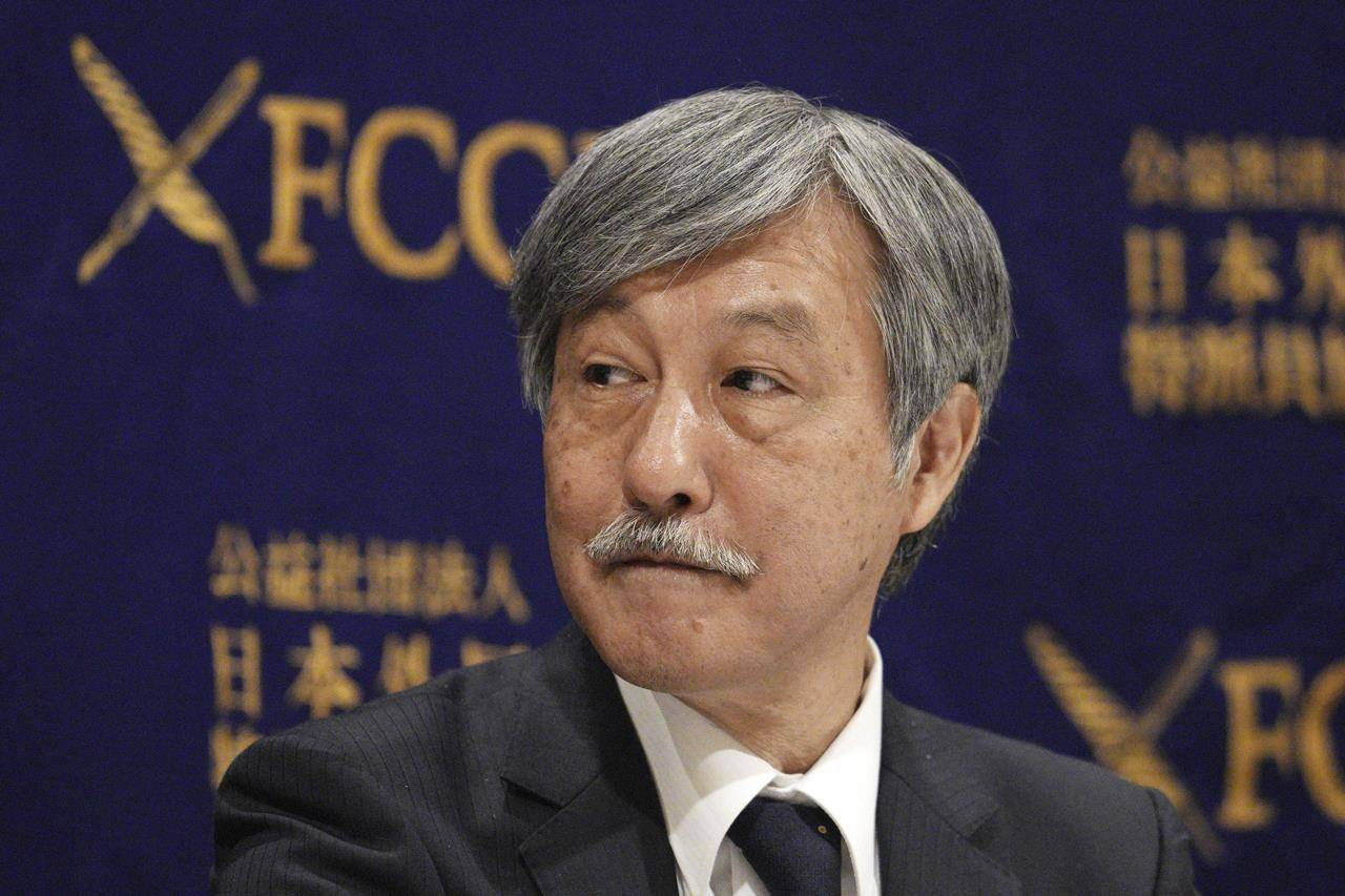 Dr. Naoto Ueyama, chairman of Japan Doctors Union, attends a press conference Thursday, May 27, 2021, in Tokyo. Dr. Ueyama warned Thursday that holding the one-year-delayed Tokyo Olympics in two months could lead to the spread of mutant variants of the coronavirus. (AP Photo/Eugene Hoshiko)
