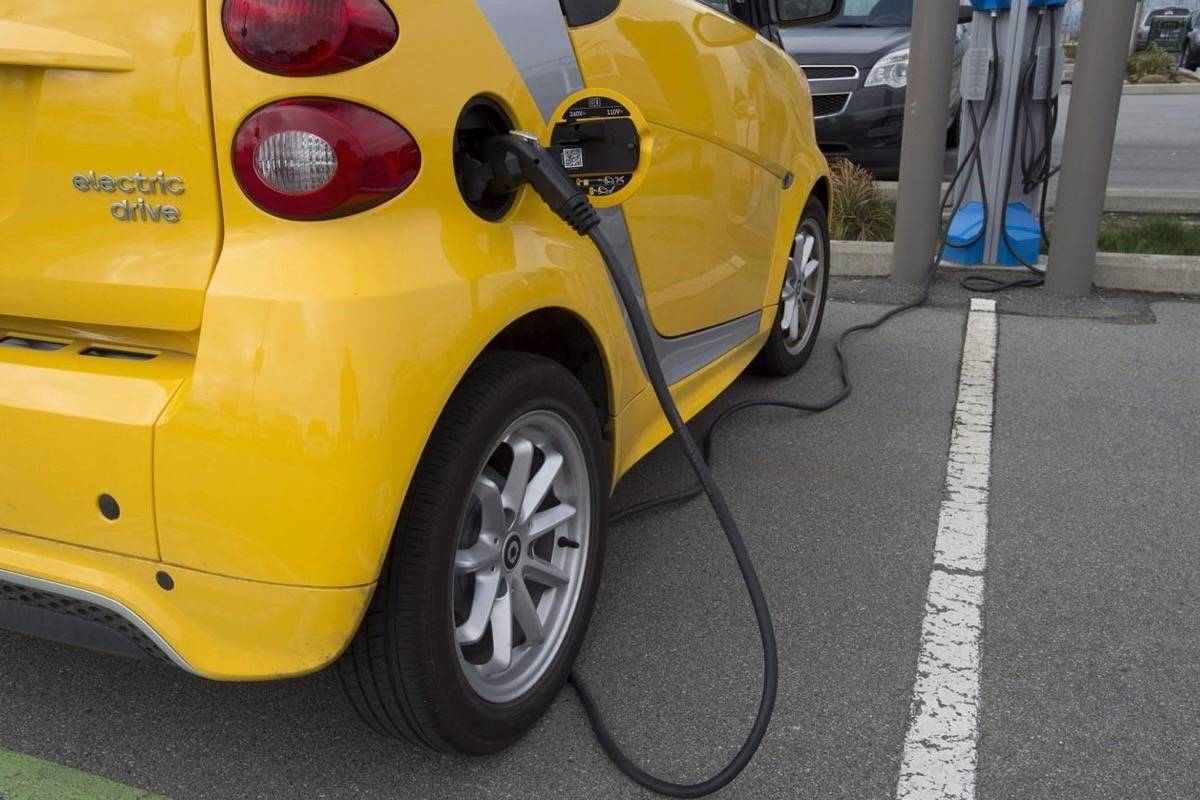 A electric car is seen getting charged at parking lot in Tsawwassen, near Vancouver B.C., April, 6, 2018. THE CANADIAN PRESS/Jonathan Hayward