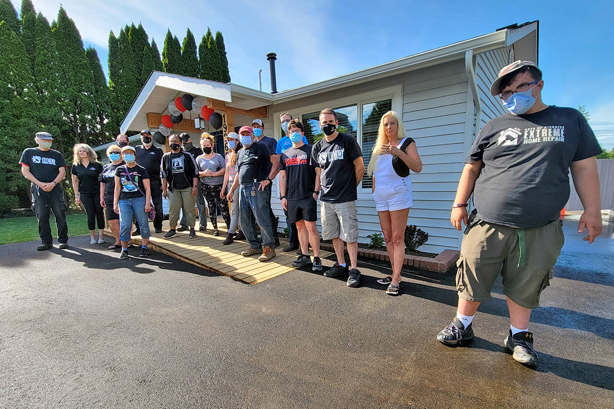 Crew members posed outside the home of Ken and Sandra Murphy Sunday before it was turned over by the Acts Of Kindness Extreme Home Renovation initiative. (Dan Ferguson/Langley Advance Times)