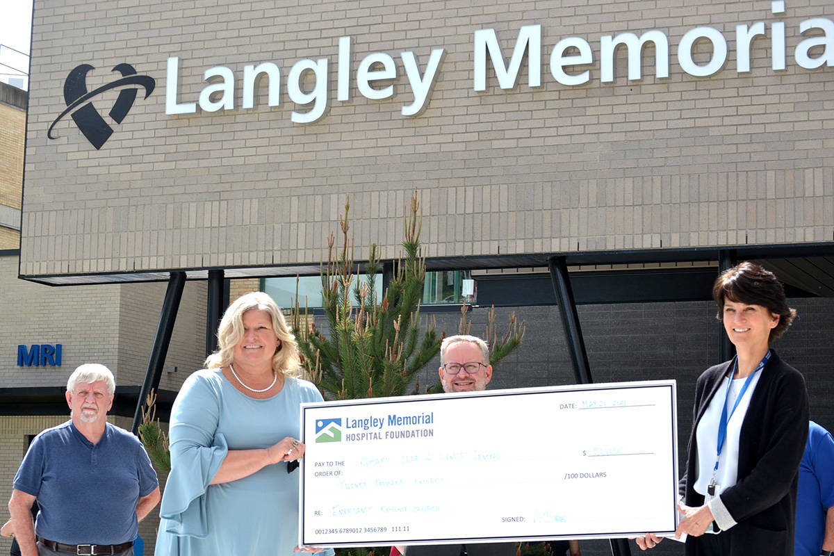 Annett Borrows, President Elect of the Rotary Club of Langley Central, presents a $20,000 donation to Heather Scott, executive director of the LMH Foundation. (Ryan Uytdewlligen/Aldergrove Star)
