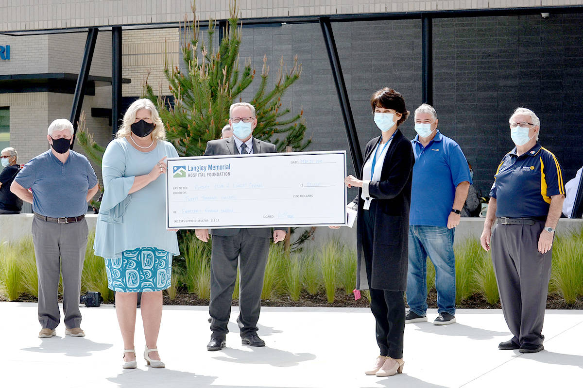 Annett Borrows, President Elect of the Rotary Club of Langley Central, presents a $20,000 donation to Heather Scott, executive director of the LMH Foundation, and LMH executive director Jason Cook, alongside rotarians Paul Coltura, John Peters, and Mike Brown. (Ryan Uytdewlligen/Aldergrove Star)