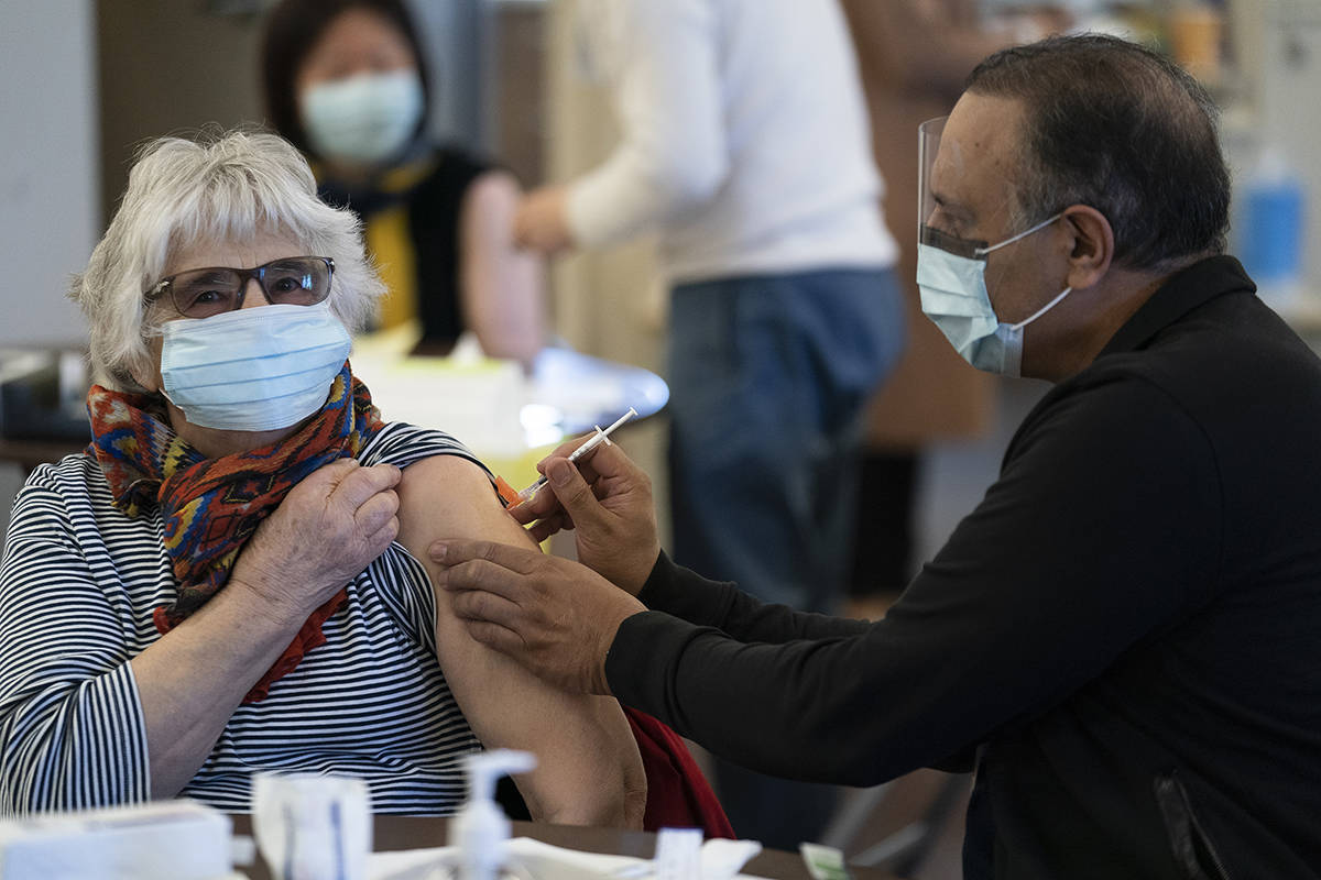 A woman receives a COVID-19 vaccine at a vaccination clinic run by Vancouver Coastal Health, in Richmond, B.C., Saturday, April 10, 2021. THE CANADIAN PRESS/Jonathan Hayward