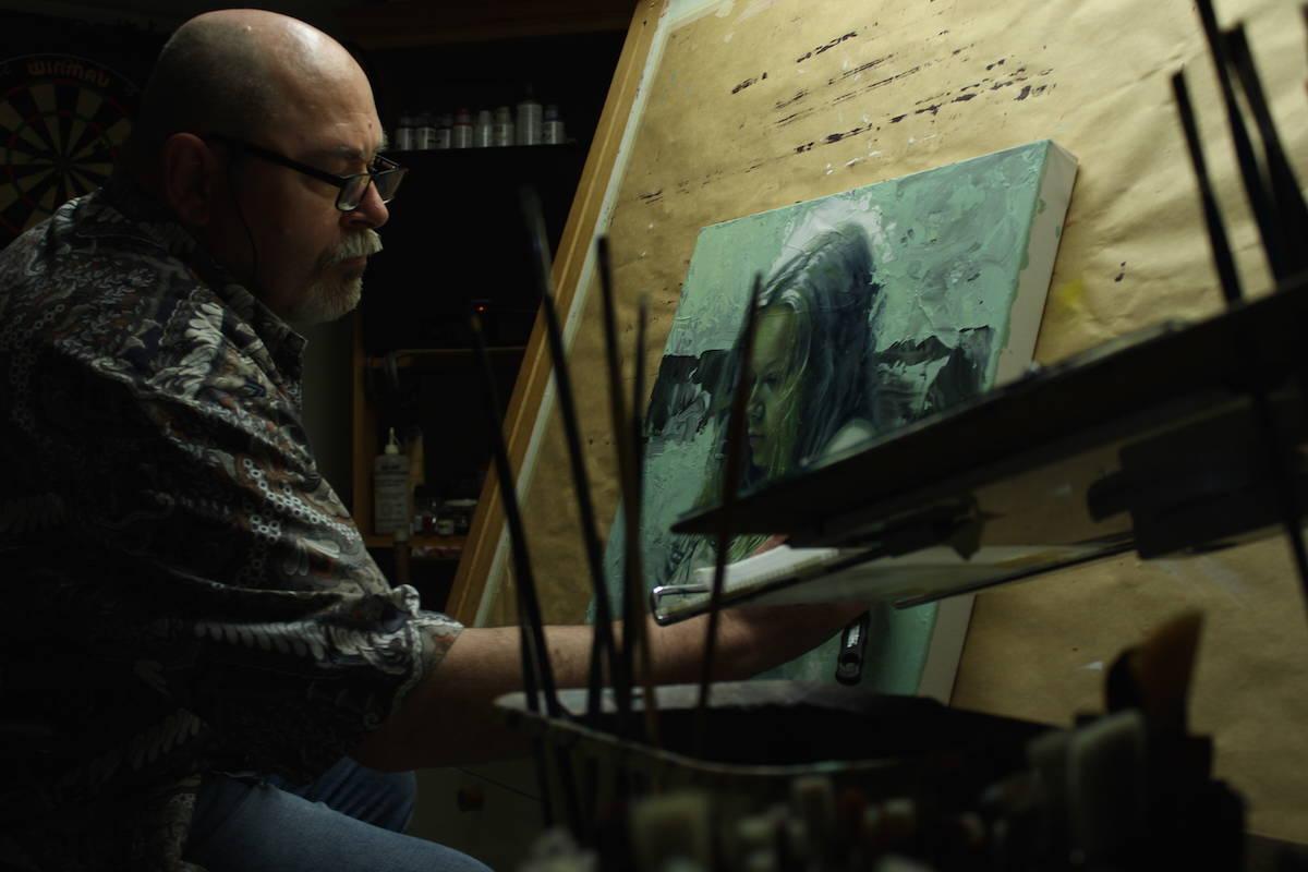 Mark Heine paints in his Victoria studio. (Jake Romphf/News Staff)