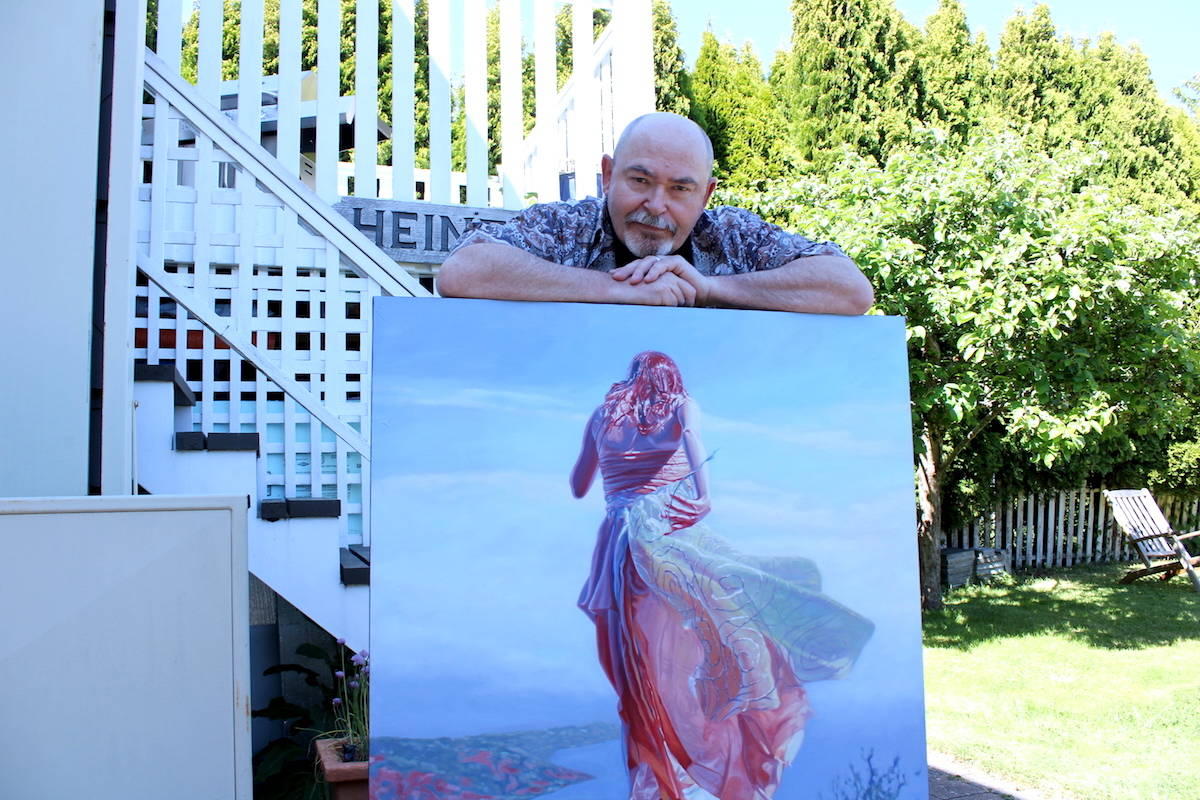Victoria artist Mark Heine with a painting from his Sirens series. Two pieces from the series will go to the moon later this year. (Jake Romphf/ News Staff)