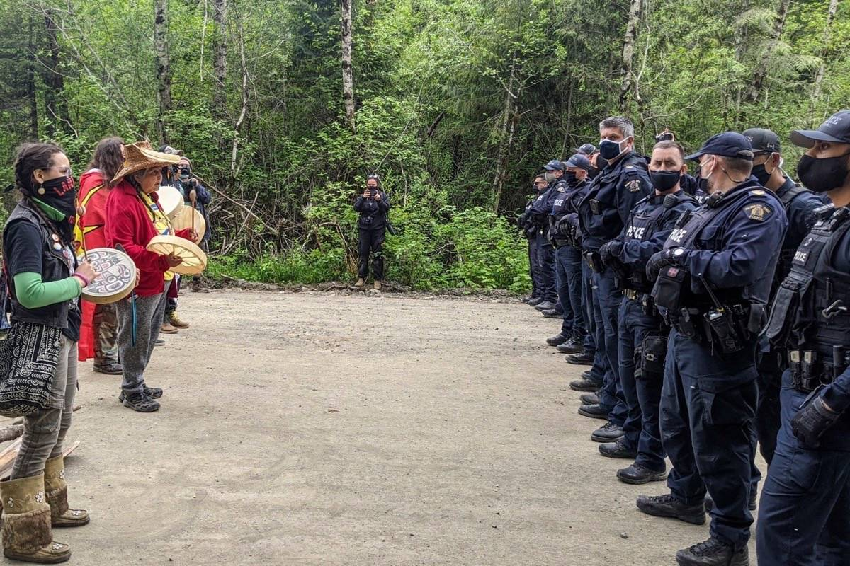 Protesters and RCMP officers engage in a stand-off at an old-growth logging blockade near Fairy Creek on Thursday, May 27. (Facebook photo)