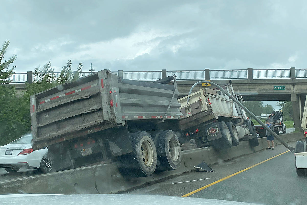 A dump truck and trailer got stuck on a concrete lane divider westbound on Highway One at the 264th Street interchange in Aldergrove the morning of Friday, May 28. (Camille Timmermans/Special to Black Press Media)