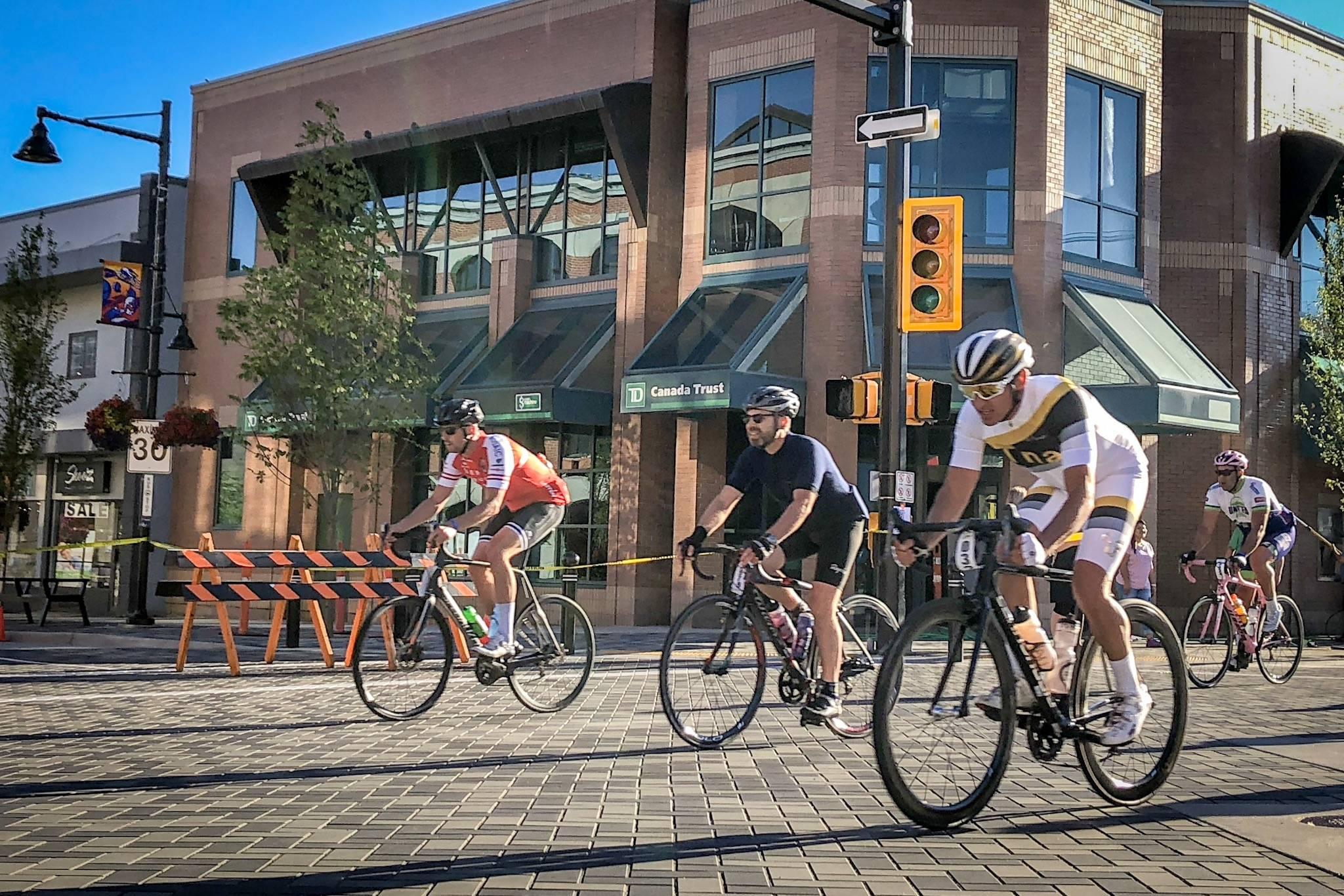Granfondo rider Lorne Paperny and other participants stream over the cobblestone streets in downton Penticton during the Granfondo Axel Merckx Okanagan cycling event. Do you know where cyclist Axel Merckx was born? (Black Press file photo)