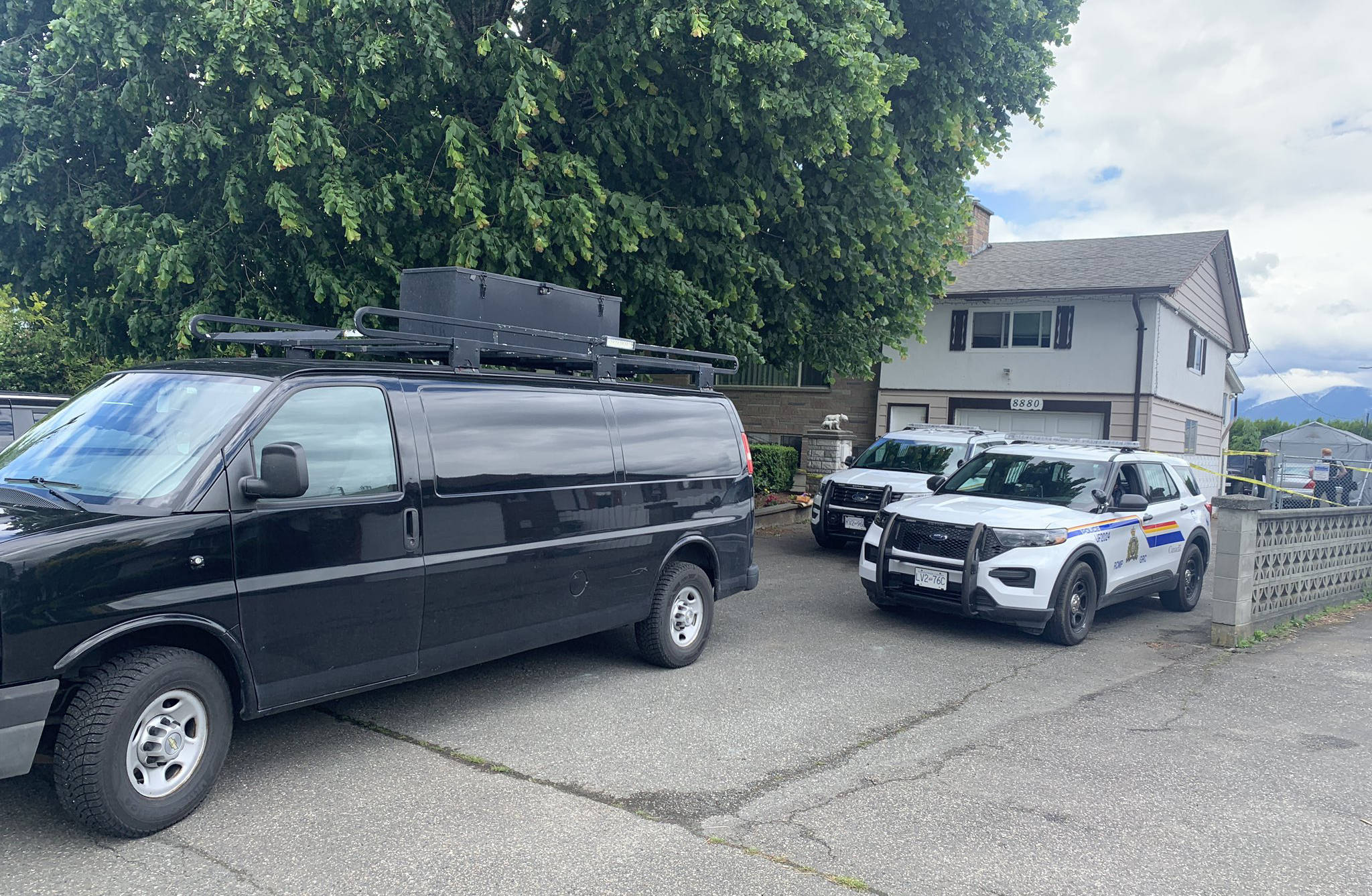 IHIT and RCMP forensics investigators are on scene at a Broadway Street house that may be connected to a shooting in Chilliwack early Thursday morning. (Paul Henderson/ Chilliwack Progress)