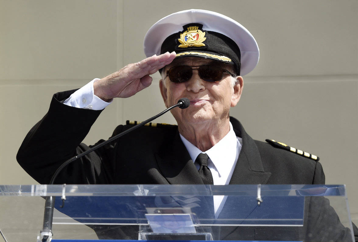 """Gavin MacLeod, a cast member on the TV series """"The Love Boat,"""" salutes the crowd as he speaks at a Friends of Hollywood Walk of Fame plaque ceremony (Chris Pizzello/AP)"""