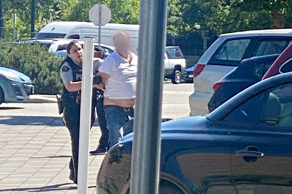 A man was led away in handcuffs from Langley City's McBurney Lane after a confrontation over alleged sexist comments. Several video clips of the incident were posted to social media, generating hundreds of comments.