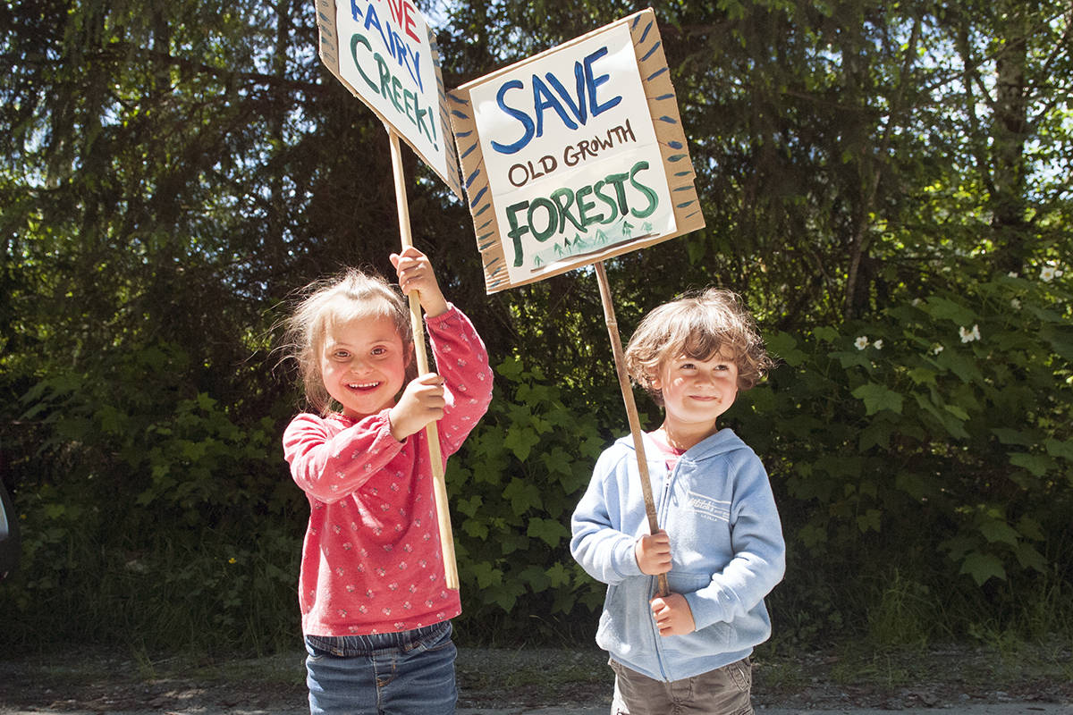 Ayana Benning, 5, and her brother Tulsie Benning, 4, marched up with their signs and parents to join the celebration at Braden Main forest service road, where the police exclusion line was breached May 29. (Zoe Ducklow/News Staff)