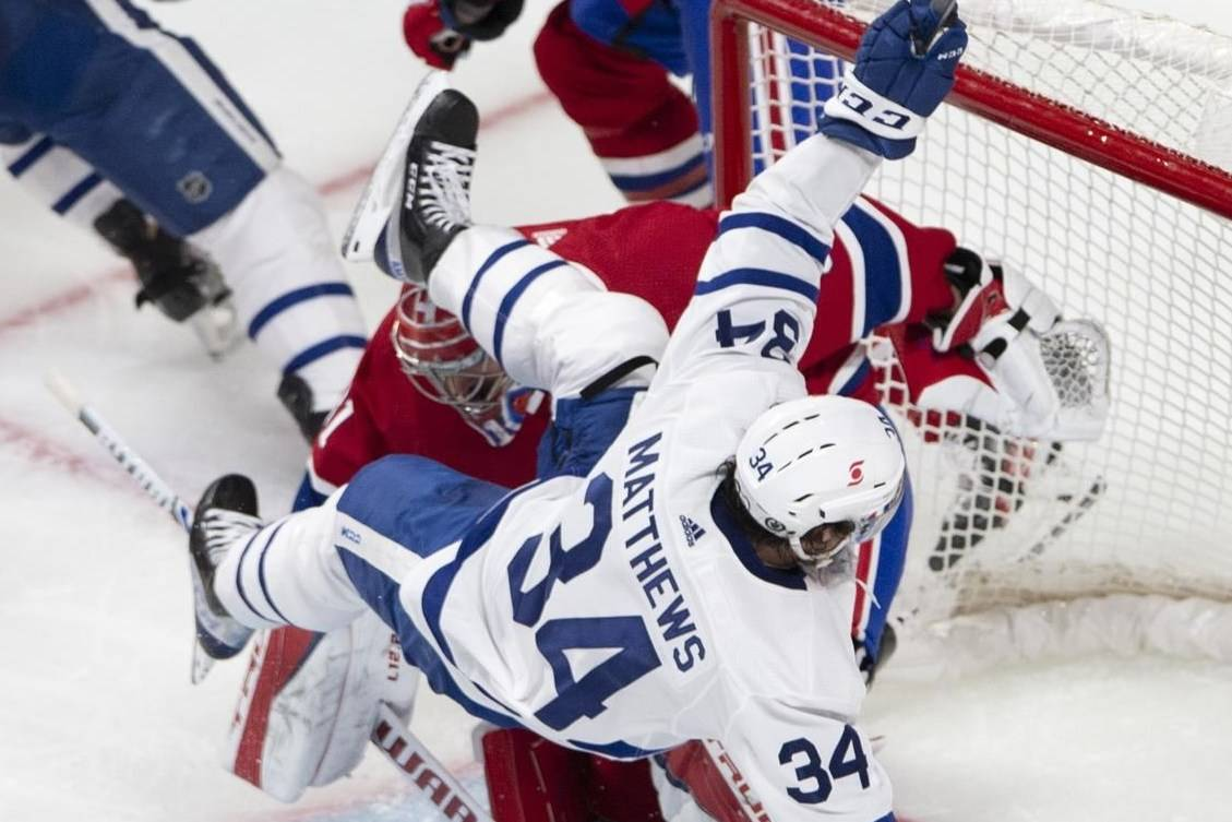 Toronto Maple Leafs centre Auston Matthews (34) falls over Montreal Canadiens goaltender Carey Price (31) during third period NHL playoff hockey action Saturday, May 29, 2021 in Montreal. THE CANADIAN PRESS/Ryan Remiorz