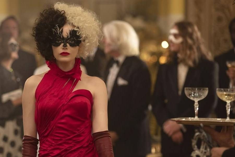 """This image released by Disney shows Emma Stone in a scene from """"Cruella."""" (Laurie Sparham/Disney via AP)"""