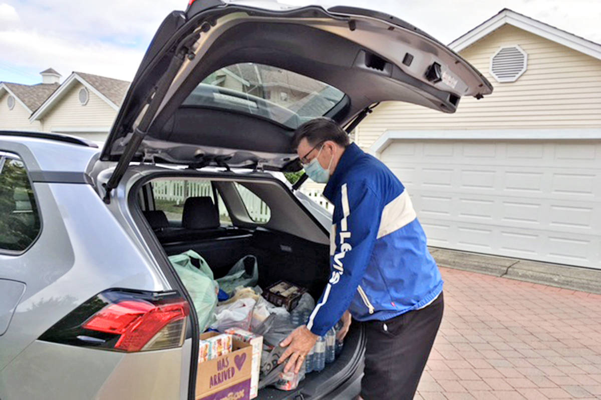 Bill Macrae loaded up a vehicle on Friday, May 28, with the latest monthly contributions to the Langley Sources Food Bank by residents of Churchill Park in Walnut Grove. (Carol Gilchrist/special to Langley Advance Times)