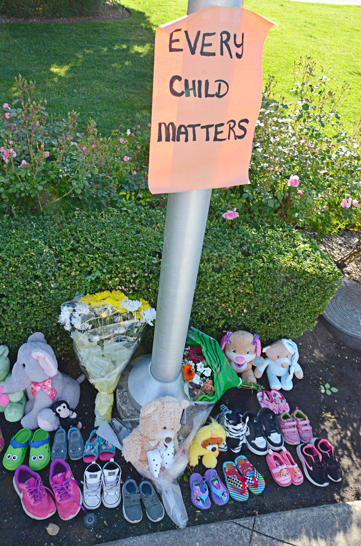 A memorial to the 215 dead children buried at the Kamloops residential school has been set up in Douglas Park near the cenotaph. (Heather Colpitts/Langley Advance Times)