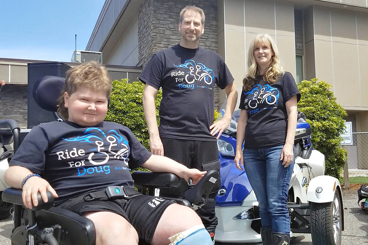 Doug Penner, with dad Cam and mom Allison, just before the June 2019 ride got underway. (Langley Advance Times File)