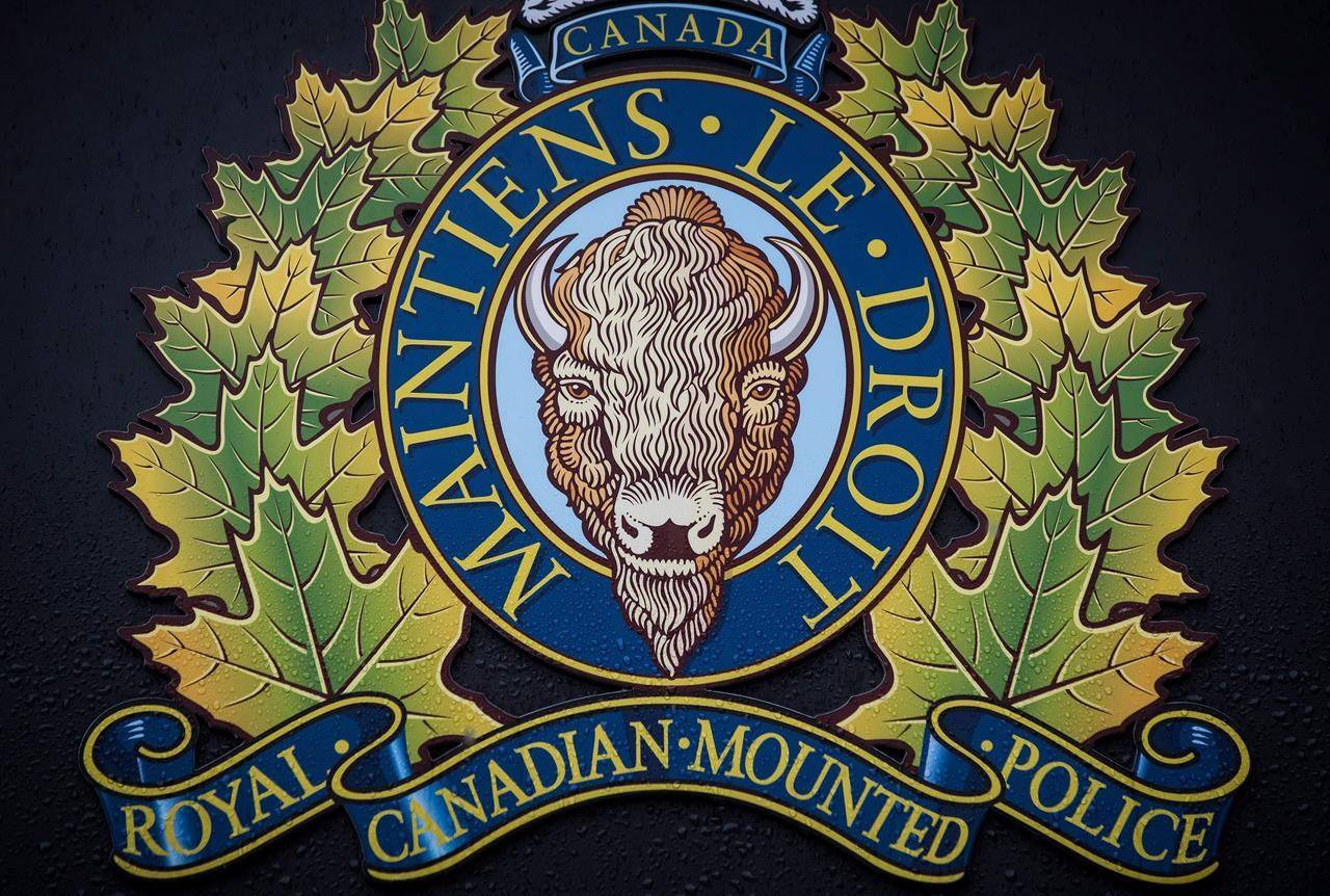 """The RCMP logo is seen outside Royal Canadian Mounted Police """"E"""" Division Headquarters, in Surrey, B.C., on April 13, 2018. THE CANADIAN PRESS/Darryl Dyck"""