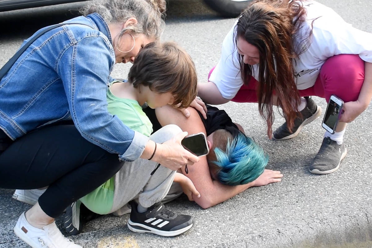 Rachelle Seidel collapses to the ground after seeing her renovated home Sunday evening. (Aaron Hinks photo)