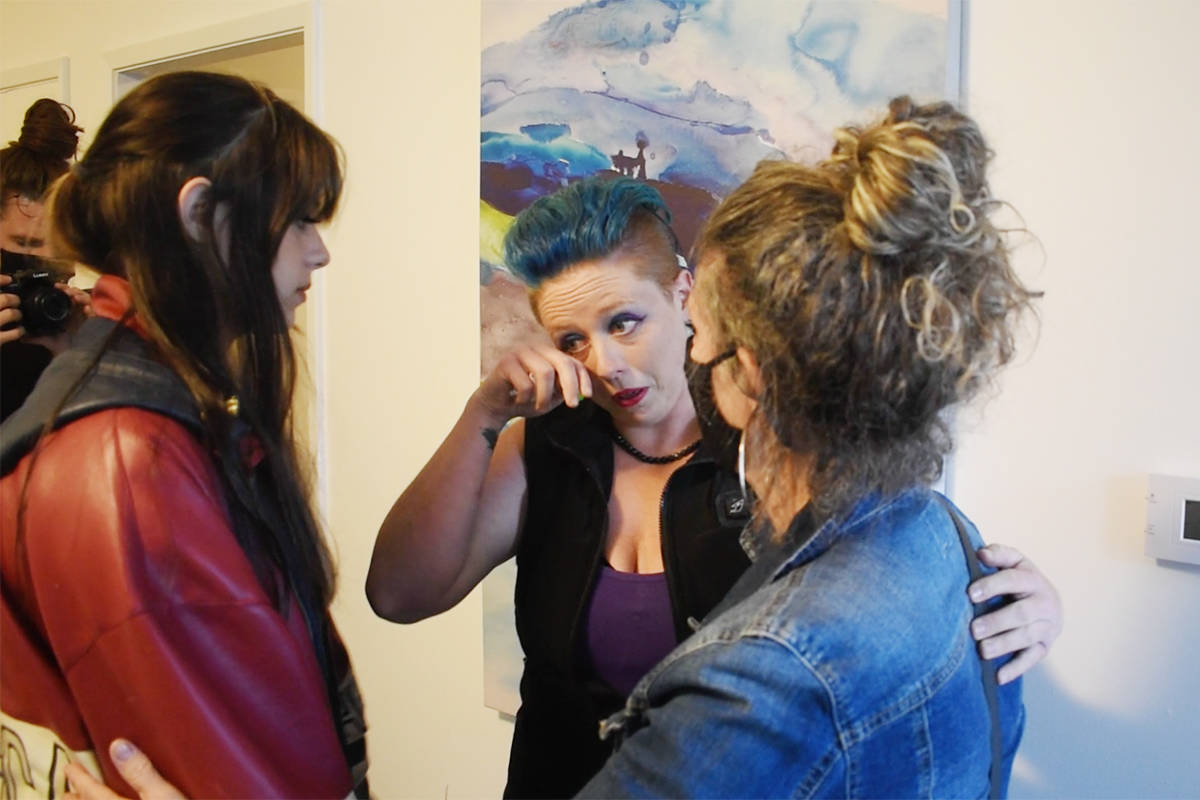 Rachelle Seidel wipes away a tear while being comforted by her daughter and LifeApp human resources director Teresa Penner. (Aaron Hinks photo)