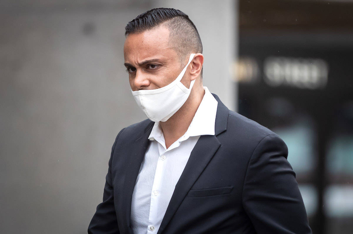 Mohammad Movassaghi, 42, leaves provincial court in Vancouver on Wednesday, April 28, 2021. THE CANADIAN PRESS/Darryl Dyck