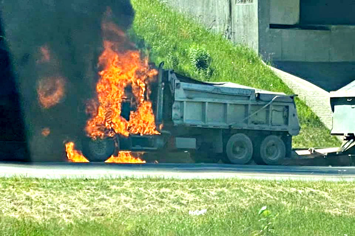 Langley Township was called to a vehicle fire on the Trans Canada Highway at about 248th Street on Tuesday afternoon. The fire blocked traffic temporarily with motorists rerouting. (Submitted photo)