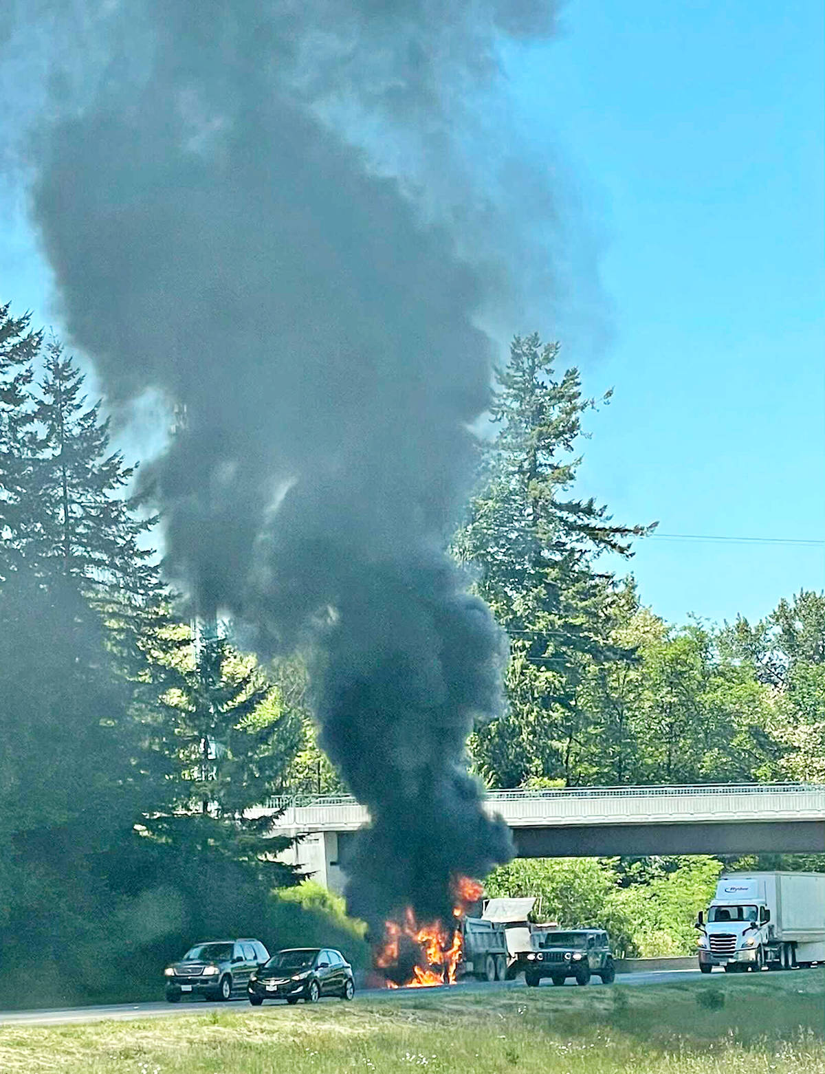 Township fire crews responded to a truck fire on Highway 1 at 248th Street on Tuesday afternoon. (Submitted photo: Jenna Caul-Zillich)