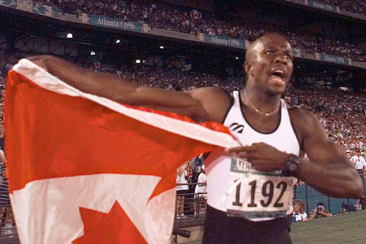 Donovan Bailey of Canada celebrates after winning the gold medal in the men's 100 meter final at the 1996 Summer Olympics in Atlanta, Saturday, July 27, 1996. (AP Photo/Ed Reinke)