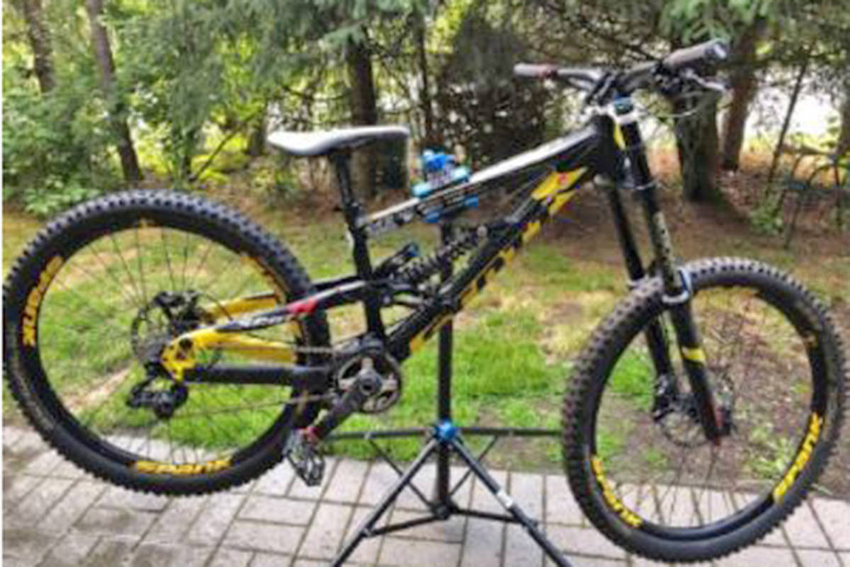 The pictured bicycle was stolen during a break and enter in Aldergrove on May 30th. The bike is a one-of-a-kind custom made Scott Voltage with yellow writing worth $3,000. (Special to Langley Advance Times)