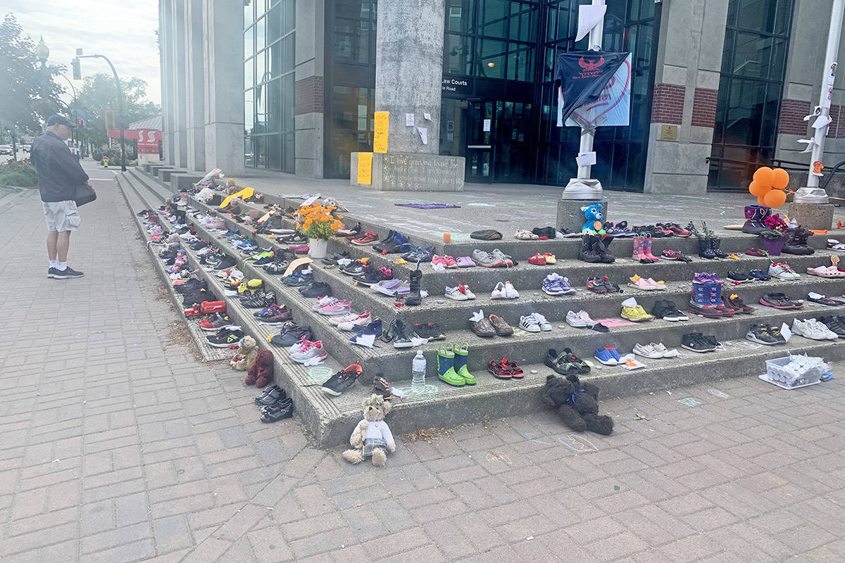 Dozens of pairs of shoes and toys and teddy bears were placed on the Chilliwack Law Court steps on May 31, 2021 in support of the 215 bodies of children found last week in an unmarked grave at the site of an old Kamloops residential school. (Paul Henderson/ Chilliwack Progress)