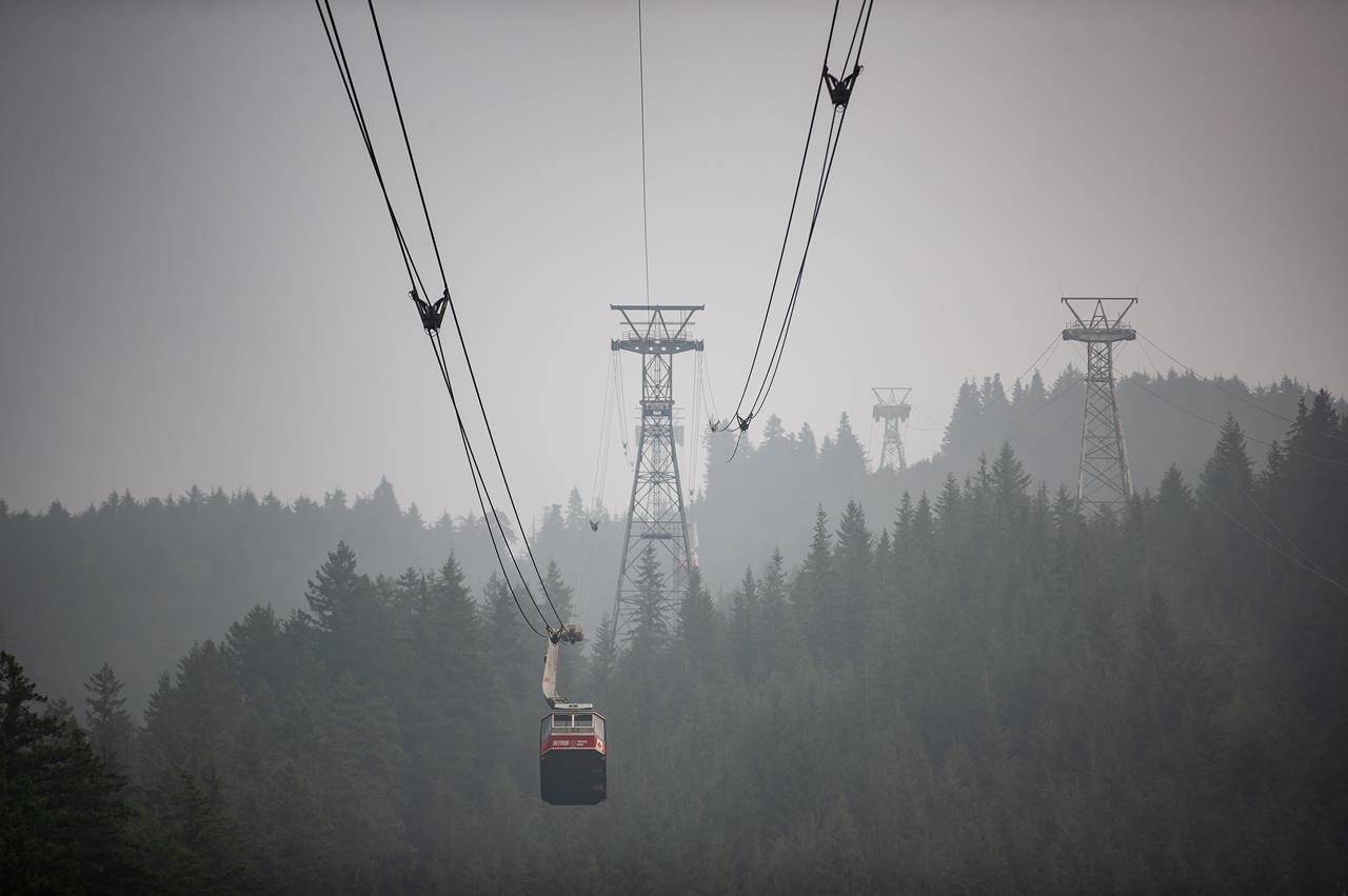 Smoke from wildfires burning in the U.S. fills the air as the Grouse Mountain tram transports people down the mountain, in North Vancouver, B.C,, on Saturday, September 12, 2020. The World Air Quality Index, a non-profit that tracks air quality from monitoring stations around the world, rated Vancouver's air quality as the second worst in the world Saturday. Environment Canada has issued a special air quality statement for Metro Vancouver, showing a very high risk to health due to wildfire smoke from Washington and Oregon. THE CANADIAN PRESS/Darryl Dyck