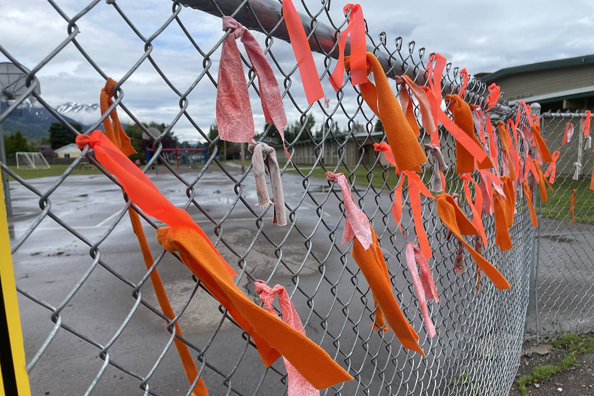 215 orange ribbons are tied to a B.C. school's fence to honour the 215 children who lost their lives and were buried at the former residential school in Kamloops. (Deb Meissner photo)