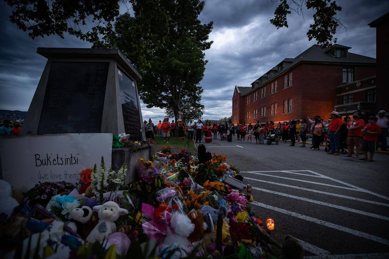 People sing and drum outside the former Kamloops Indian Residential School to honour the 215 children whose remains have been discovered buried near the facility, in Kamloops, B.C., on Monday, May 31, 2021. THE CANADIAN PRESS/Darryl Dyck