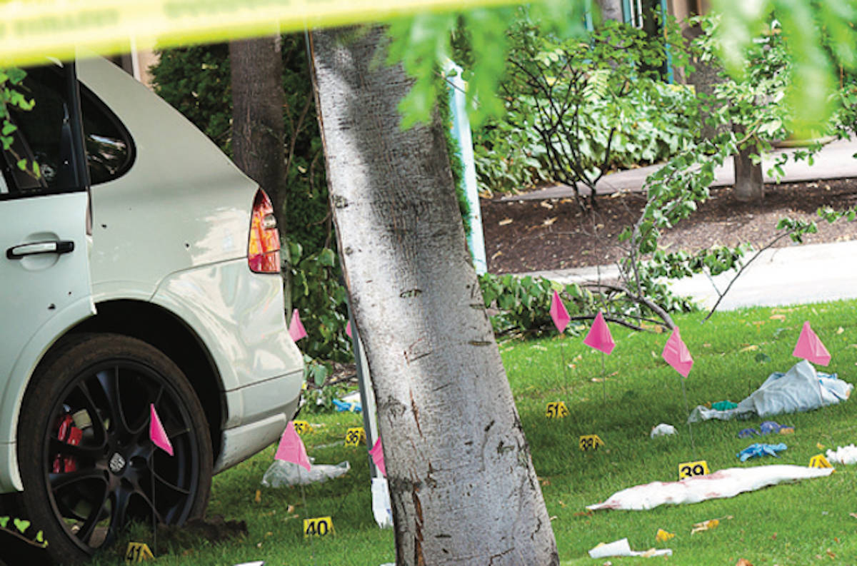 Bullets were everywhere after the Kelowna shooting of 30-year-old Red Scorpion gangster Jonathan Bacon on Aug. 14, 2011. (Black Press Media files)