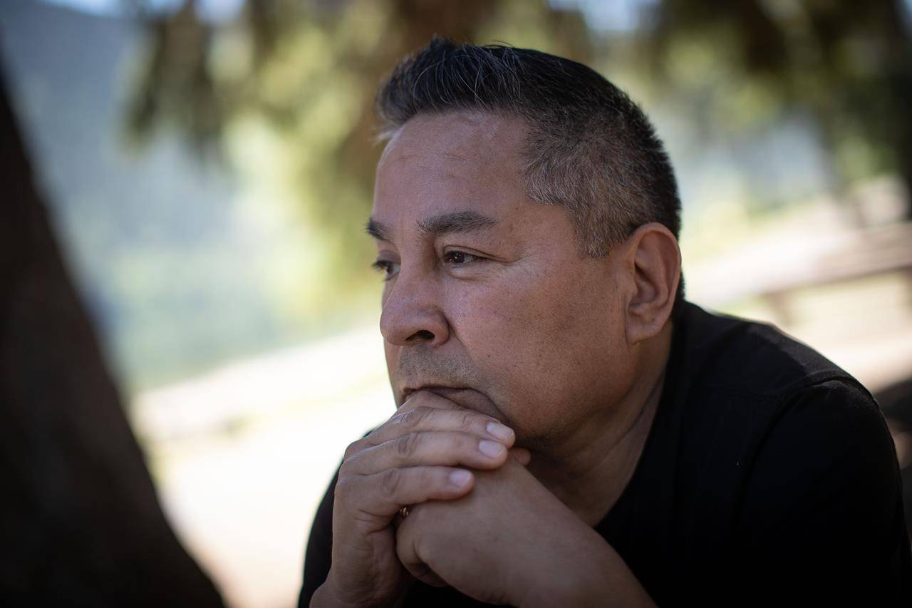 Kamloops Indian Residential School survivor Garry Gottfriedson pauses during an interview at Paul Lake near Kamloops, B.C., on Tuesday, June 1, 2021. A First Nation says the remains of 215 children have been discovered buried near the former school. THE CANADIAN PRESS/Darryl Dyck