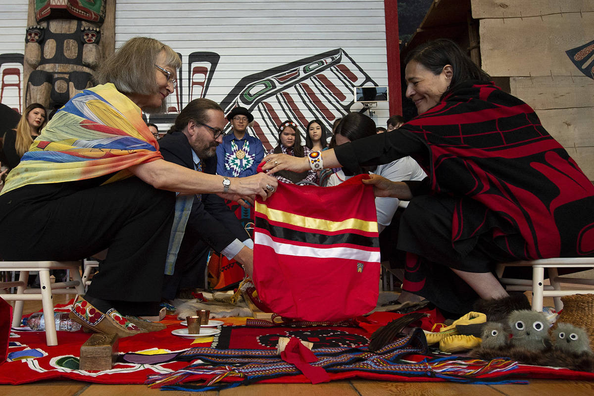FILE – Commissioners Marion Buller (left) and Commissioner Michele Audette prepare the official copy of the report for presentation to the government during ceremonies marking the release of the Missing and Murdered Indigenous Women report in Gatineau June 3, 2019. THE CANADIAN PRESS/Adrian Wyld
