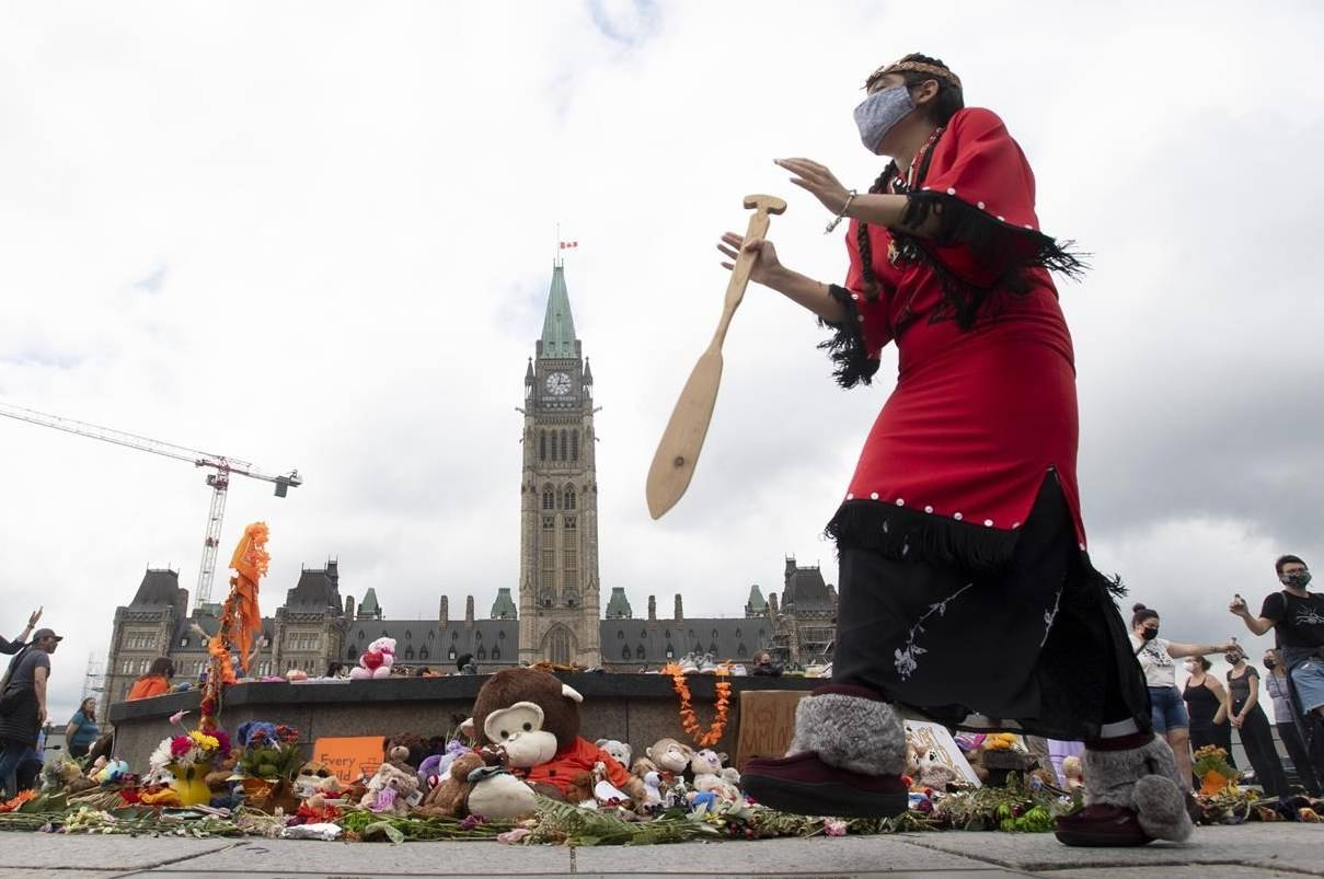 Nisga'a dancer Rosita Martinez takes part in a ceremony on Parliament Hill Thursday June 3, 2021 in Ottawa. A bill creating a statutory holiday to commemorate the tragic legacy of residential schools in Canada has been passed unanimously by the Senate. THE CANADIAN PRESS/Adrian Wyld