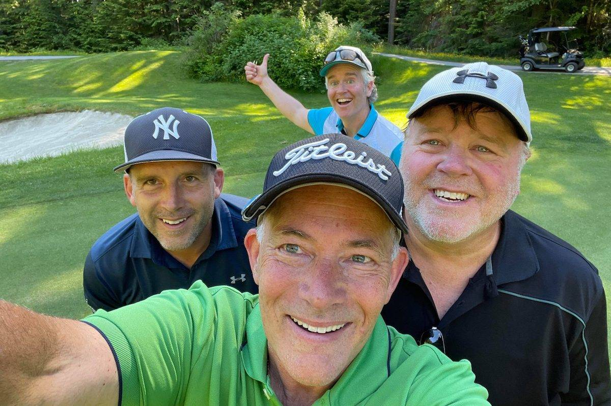 Golfers (from left) Todd Peryk, Mark Pettie, Mike McClenahan, Gary Koley at Coquitlam's Westwood Plateau golf club, where they encountered a black bear on May 25.