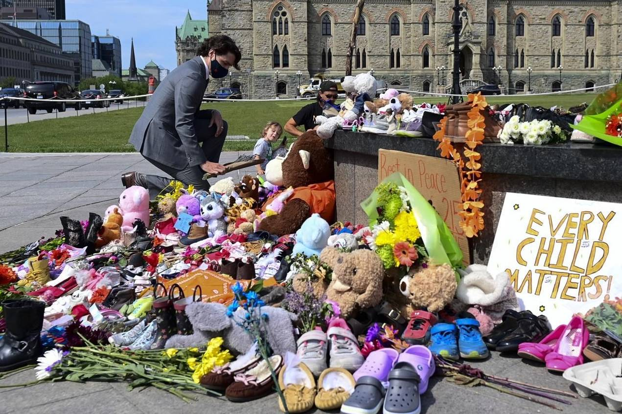 Prime Minister Justin Trudeau visits a memorial at the Eternal flame on Parliament Hill in Ottawa on Tuesday, June 1, 2021, which is in recognition of discovery of children's remains at the site of a former residential school in Kamloops, B.C. THE CANADIAN PRESS/Sean Kilpatrick
