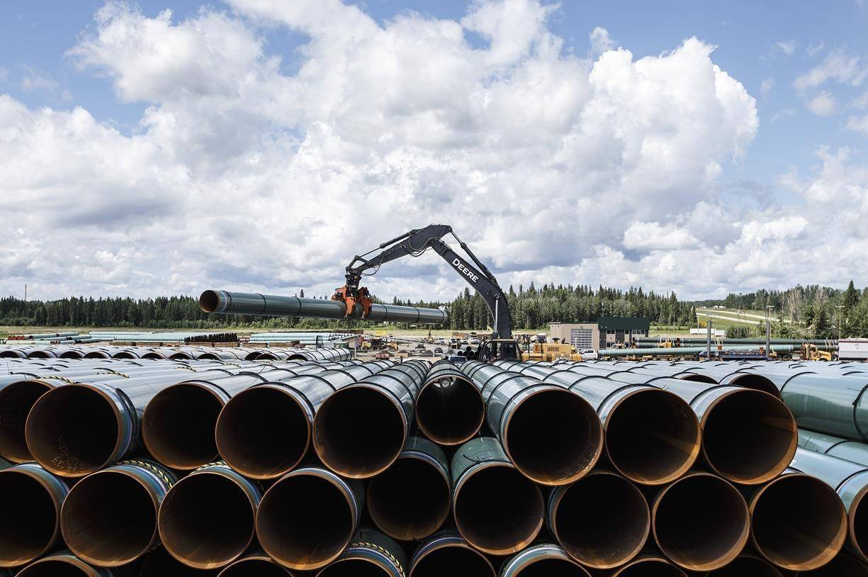 Pipe for the Trans Mountain pipeline is unloaded in Edson, Alta., Tuesday, June 18, 2019. The question of does Canada still need another pipeline outside of Line 3 and Trans Mountain was one federal officials asked days after United States President Joe Biden cancelled the permit for the Keystone XL oil pipeline.THE CANADIAN PRESS/Jason Franson