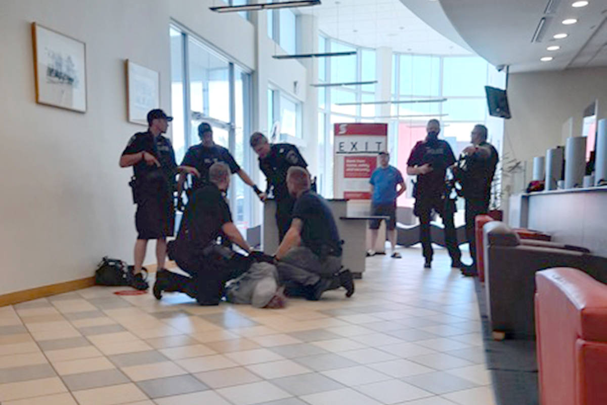 Police arrest the suspect in an attempted armed bank robbery on Wednesday morning (June 2) at the Scotiabank at Gladwin Road and South Fraser Way in Abbotsford. (Photo by Garry Amyot)