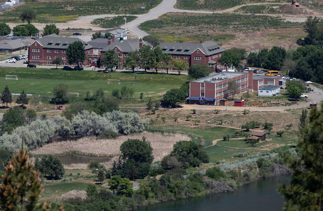 The former Kamloops Indian Residential School is seen in Kamloops, B.C., on Tuesday, June 1, 2021. The remains of 215 children have been discovered buried near the former school. THE CANADIAN PRESS/Darryl Dyck